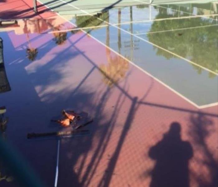 Building Services Flooded Tennis Court